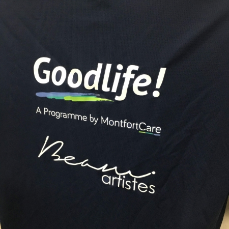 Montfort care - Navy Cool Dri-Fit T-Shirt (back angled view)